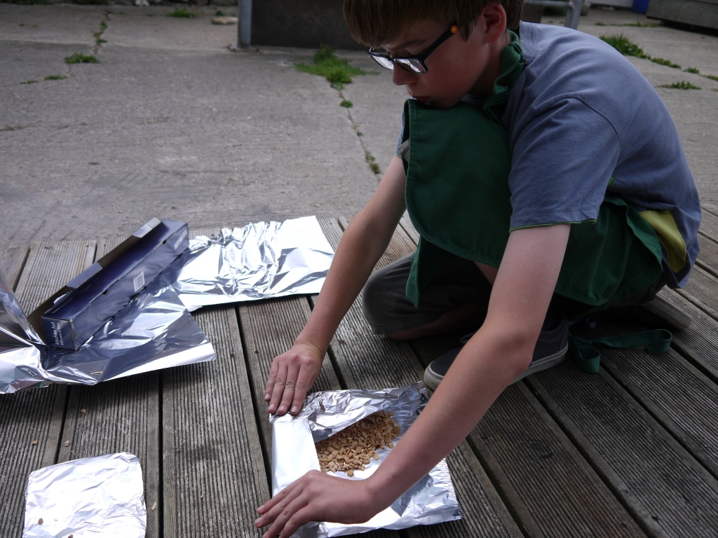 Gabriel preparing wood chips for smoking